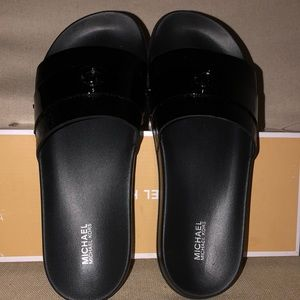 Michael Kors NBW black patent slides sz 9 in box.
